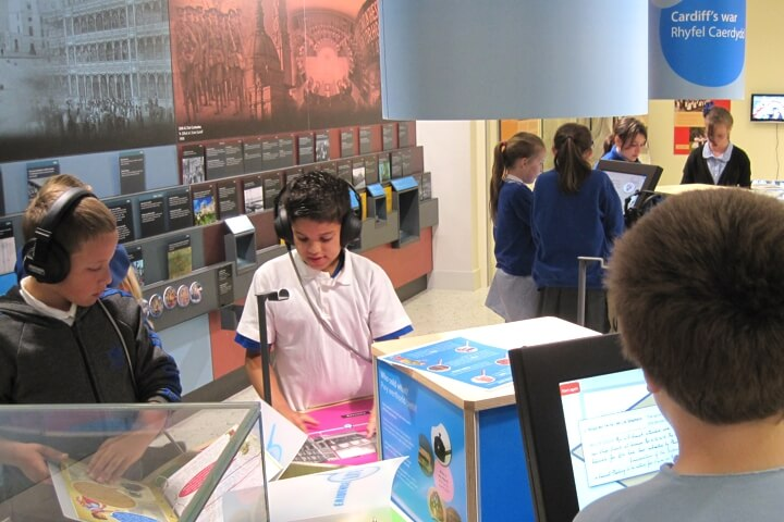 School children using interactive displays at the museum.