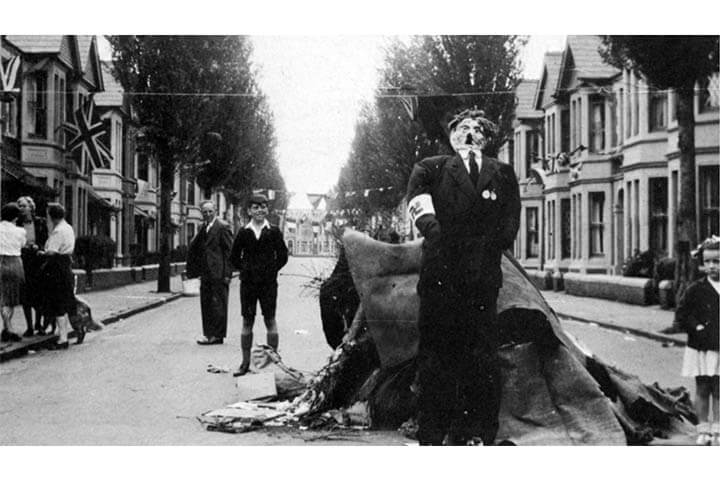 Black and white photo. VE Day street celebrations with a Hitler effigy for the bonfire.