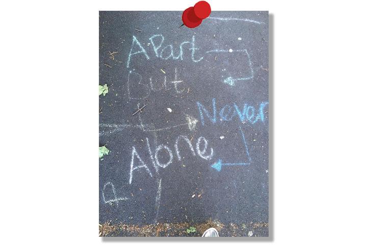 Chalk message on pavement.