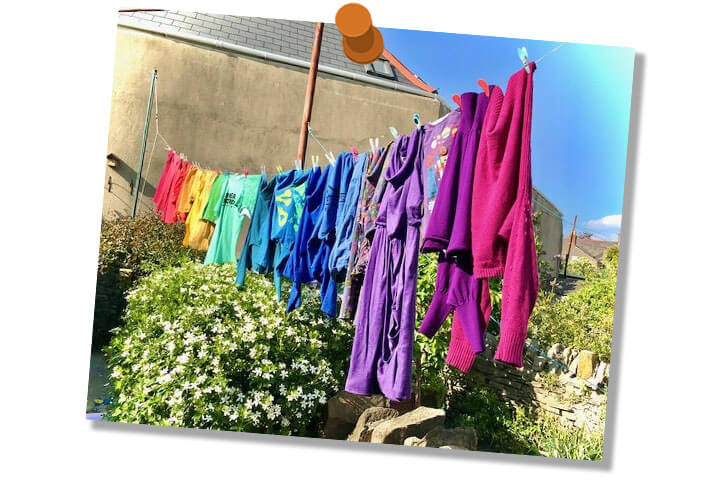 Colourful clothes on washing line.